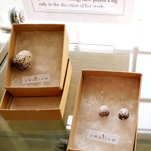 Ceramic earrings and a necklace in the shape of swallows eggs